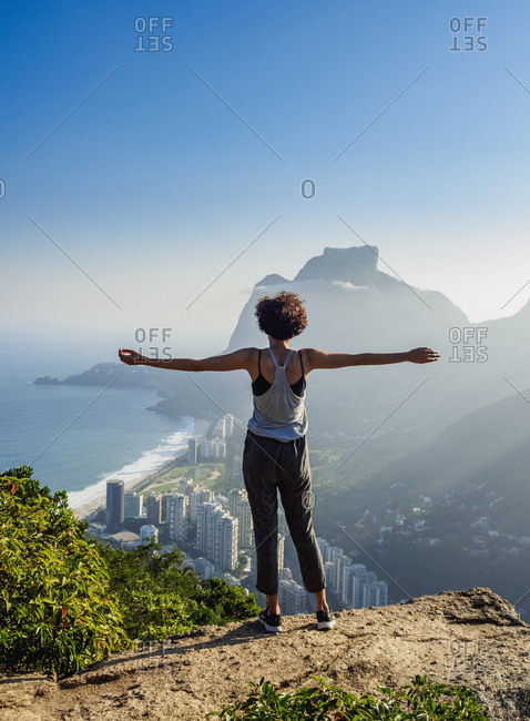 Rio de Janeiro, Brazil, South America - June 11, 2017: Brazilian girl looking towards the Pedra da Gavea and Sao Conrado from Dois Irmaos Mountain