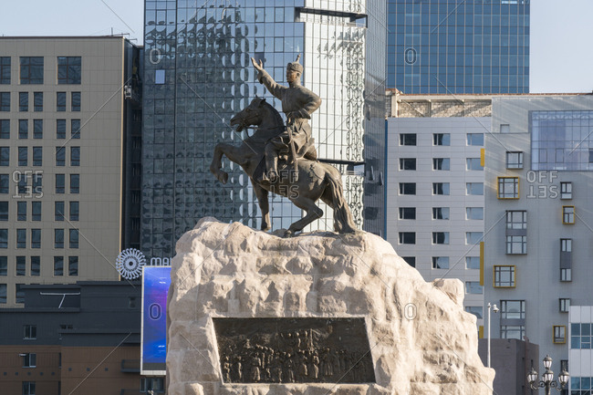 Ulan Bator, Mongolia, Central Asia, Asia - August 28, 2017: Damdin Sukhbaatar statue with skyscrapers in the background