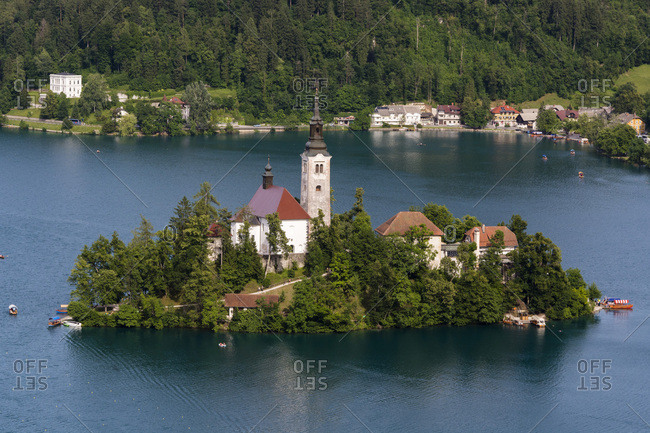 A view from above of Lake Bled and the Assumption of Mary Pilgrimage Church, Slovenia, Europe