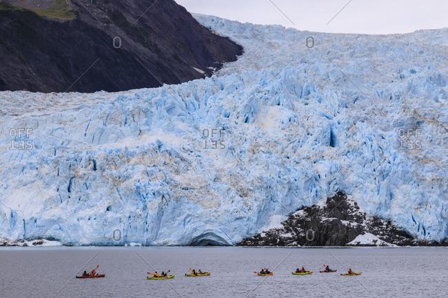 colorful kayaks, Aialik Glacier, blue ice and mountains, Harding Icefield, Kenai Fjords National Park, near Seward, Alaska, United States of America, North America