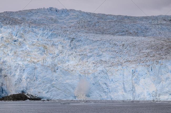 Aialik Glacier, glacial calving splash, blue ice, Harding Icefield, Kenai Fjords National Park, near Seward, Alaska, United States of America, North America