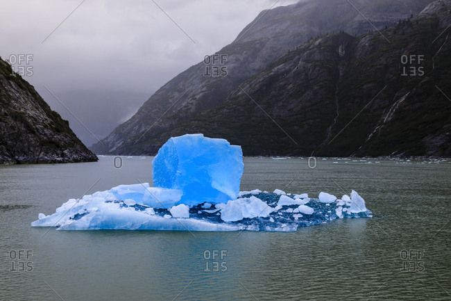 Spectacular iceberg, with stunning blue cube, Tracy Arm Fjord, misty conditions, near South Sawyer Glacier, Alaska, United States of America, North America