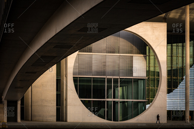 Mitte, Berlin, Germany, Europe - March 20, 2015: Man Walking in front of the Chancellery Building on the River Spree in Berlin