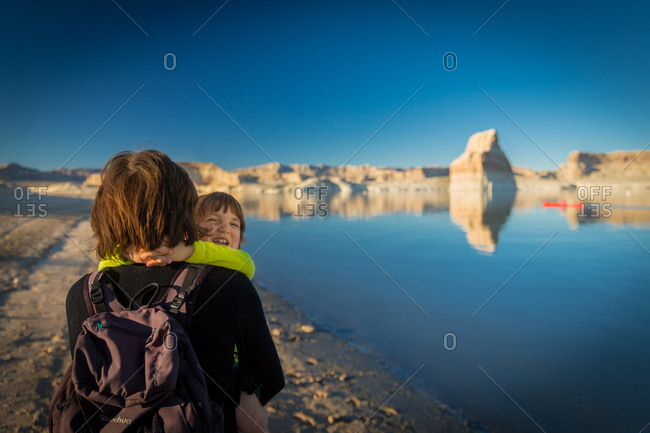 Child Laughing and Hugging His Mother on Lone Rock Beach at Lake Powell