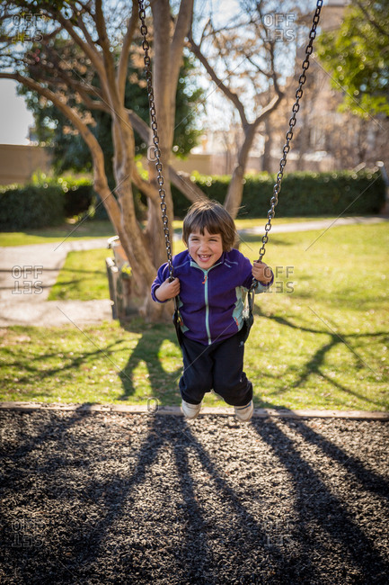 Child swinging on a swing set in the Park