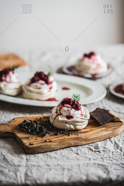 Mini pavlovas with raspberries and chocolate