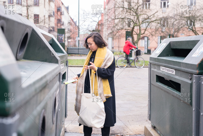 Woman sorting her recycling in bins