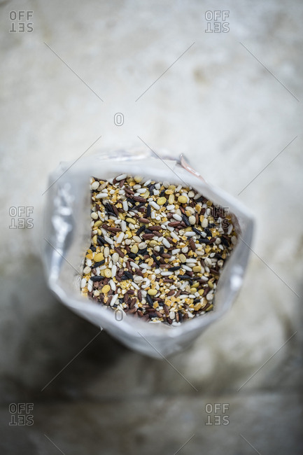 Looking down on bag of variety of uncooked rice grains