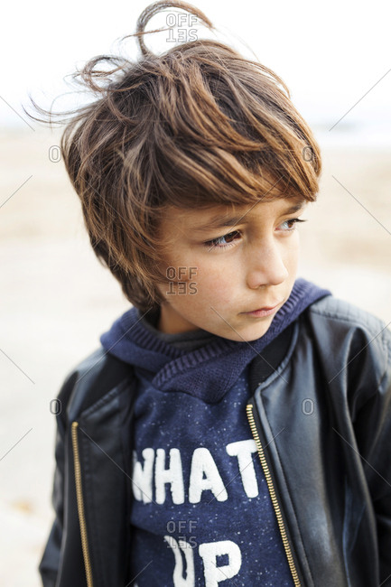 Portrait of a boy with brown hair looking away