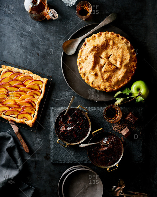A table spread of pies and desserts