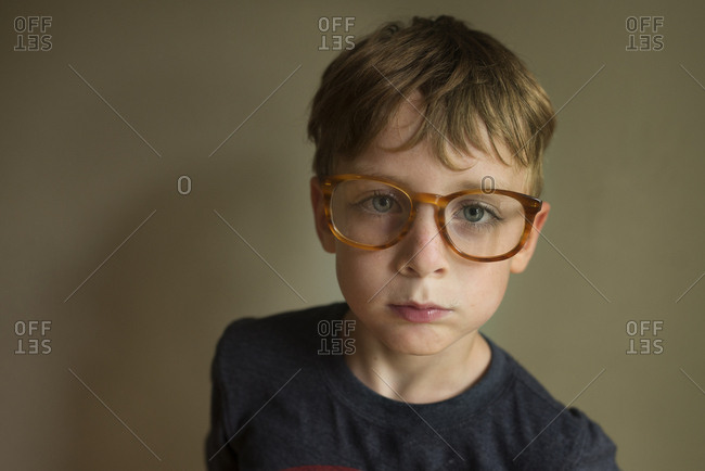 Portrait of a boy wearing glasses