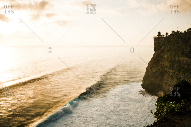 Ocean waves rolling in below cliff