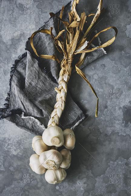 rustic moody garlic plait on linen napkin