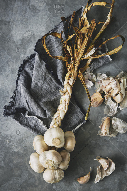 Rustic moody looking ingredient shot of a garlic plait