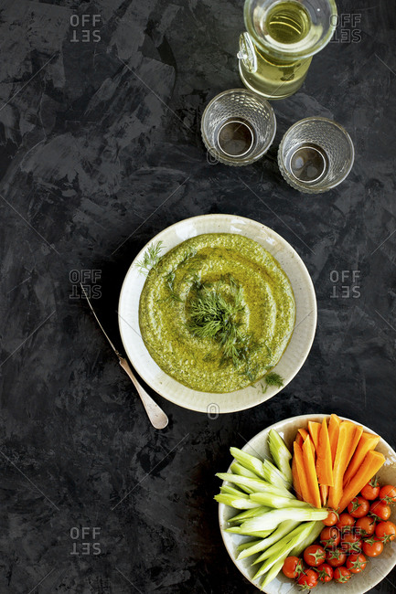 Dill pesto served with veggies and white wine