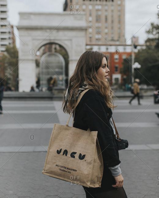 New York City - January 28, 2018: Tourist exploring Washington Square park