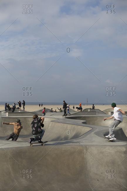Venice Beach, California - January 28, 2018: People practicing at a busy beachside skate park
