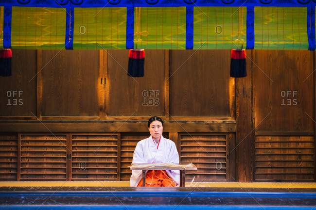 Tokyo, Japan - January 26, 2018: Tokyo, Japan - January 19, 2018: Asian woman in traditional clothes posing at wooden building