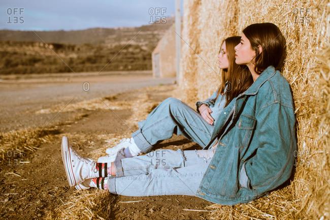 Women sitting at hay