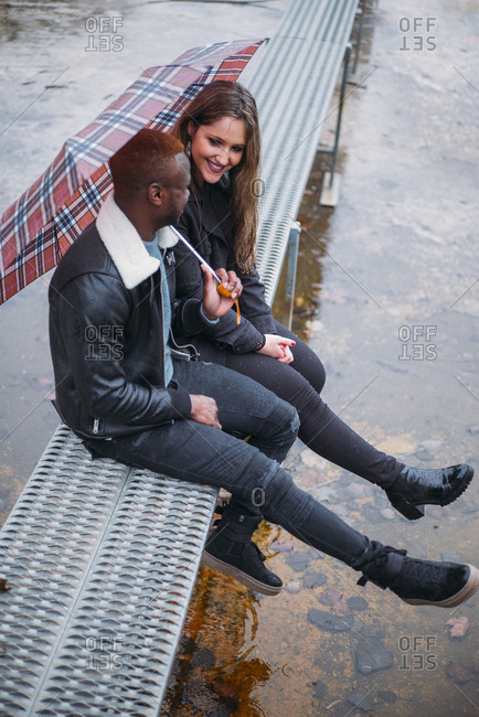 Friends who play in the street with rain Interracial relationships
