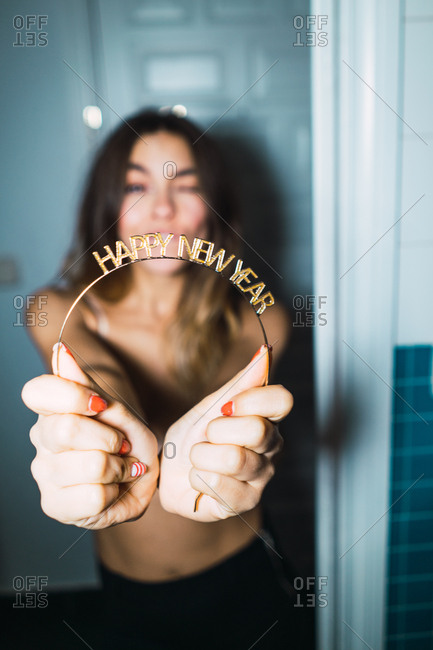 Woman with Happy New Year greeting