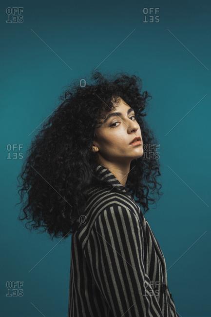 Curly woman posing in studio