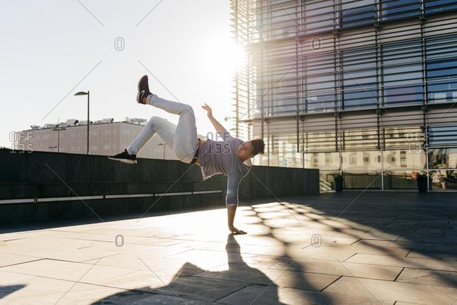 Man performing trick on street