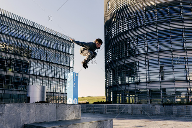 Man performing parkour in city