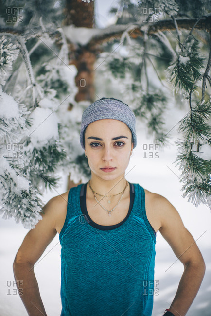 Young sportswoman woman poses in snowy area