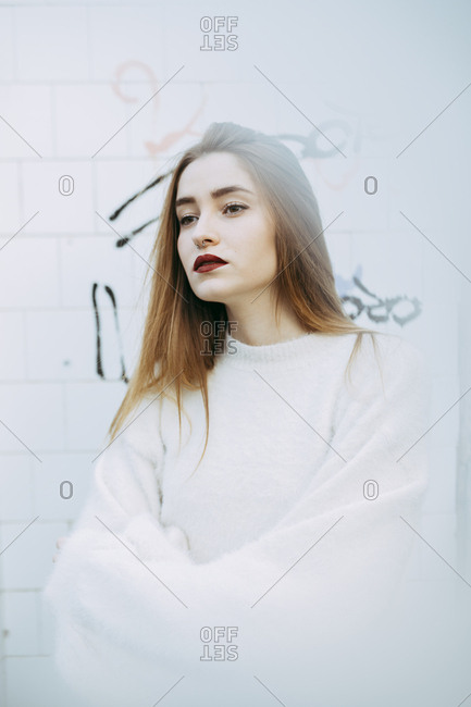 Dreamy girl in white posing in haze