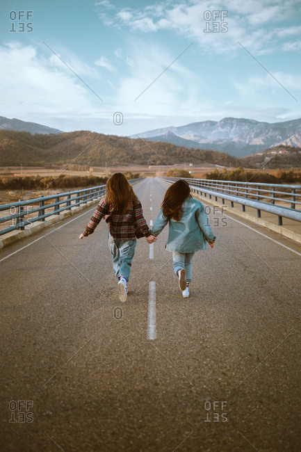 Young women running on road