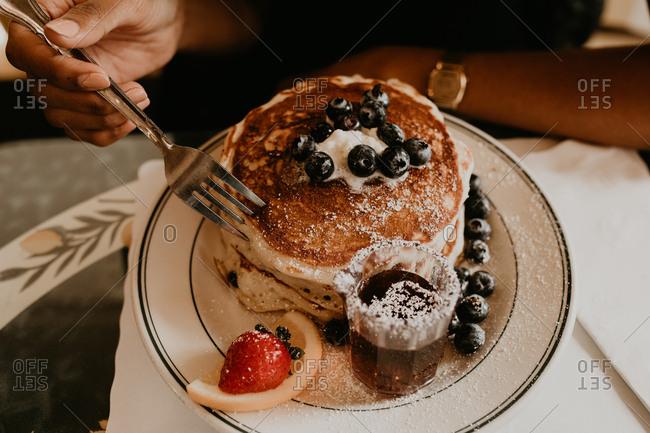 Woman having pancakes dessert