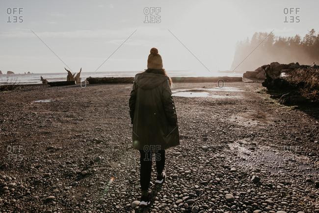 Tourist standing on cold coast