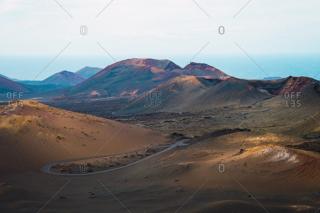 View to mountains landscape and asphalt road in Lanzarote, Spain