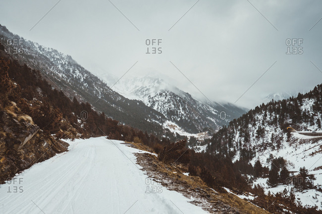 View to winter rural road in mountains covered with snow