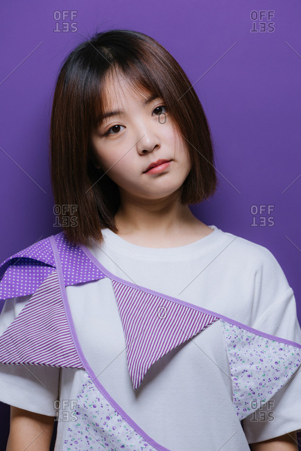 Portrait of young Chinese girl wearing a purple banner
