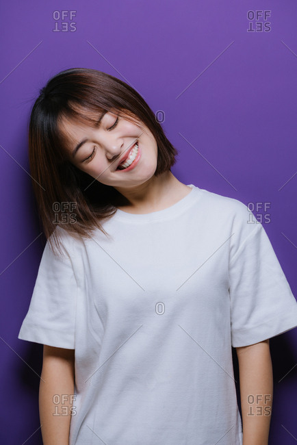 Happy Chinese girl leaning her head to the side
