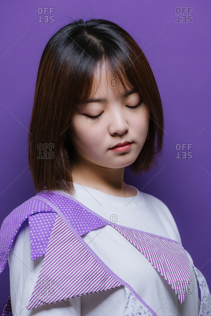 Young Chinese girl wearing a purple banner