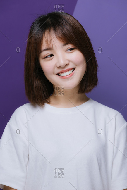 Young Chinese girl smiling and looking away