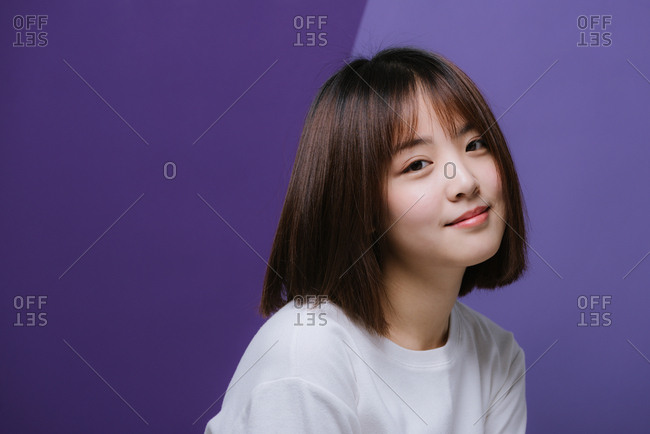Portrait of happy young Chinese girl