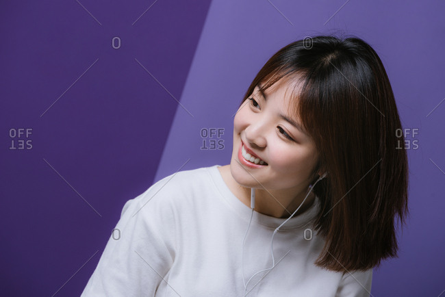 Young Chinese girl listening to headphones