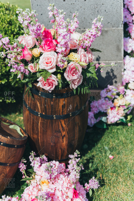 Pink flower arrangement in a wine barrel