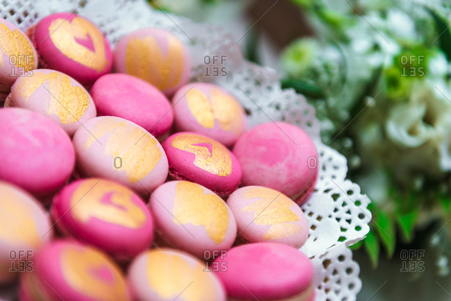 Pink macarons with gold hearts