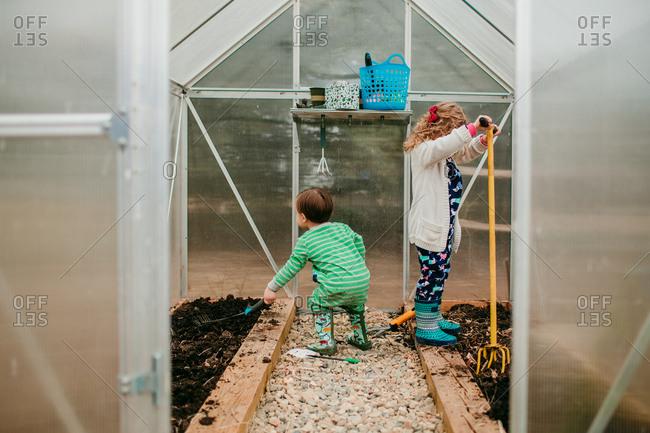 Boy and girl hard at work gardening