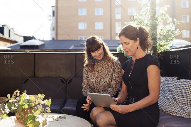 Women sitting on terrace