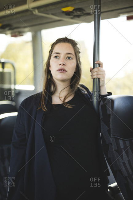 Pregnant woman traveling by bus