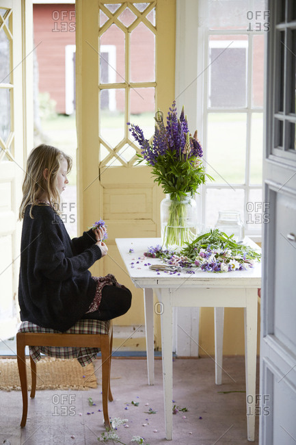 Girl sitting with flowers