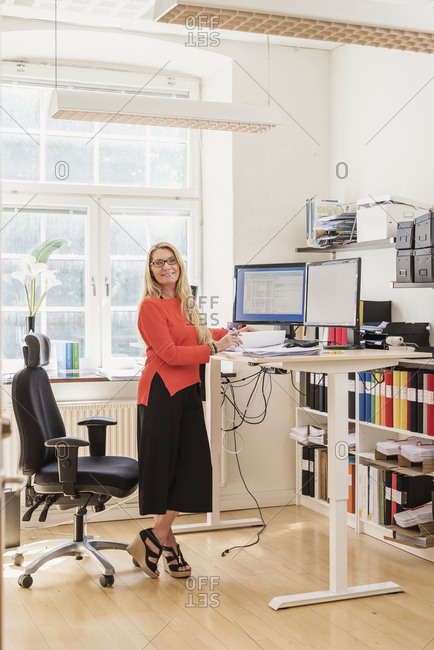 Blond woman working in office