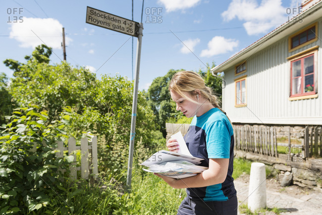 Young female mail carrier