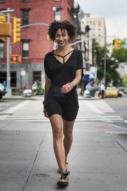 Stylish woman walking on street